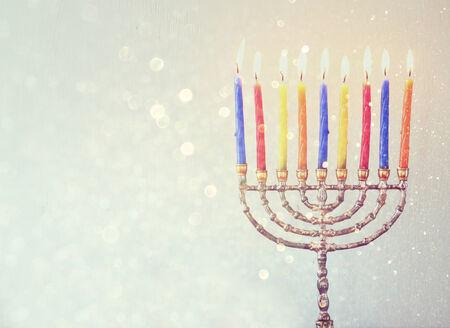 chanukiah: Image of jewish holiday Hanukkah background with menorah Burning candles over aqua glitter background