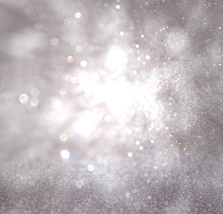 glittery: bokeh lights background with colors of white and silver and motion blur