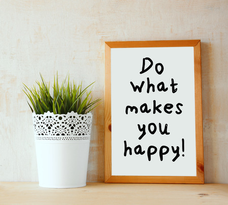 motivating: white drawing board with the phrase \\\ do whats makes you happy \\\ written on it against textured wall