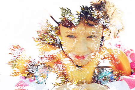 Double exposure of Colorful tree foliage in the autumn and cute happy kid