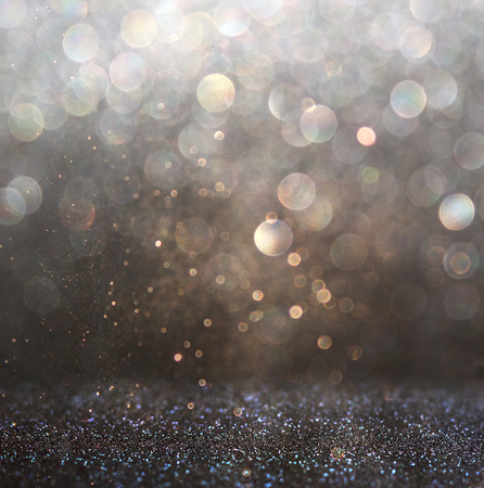 glitter vintage lights background. dark gold and black. defocused Stock Photo