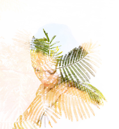 Double exposure of leaves in the beautiful young woman