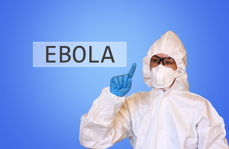 Lab scientist in safety suit drawing word ebola photo