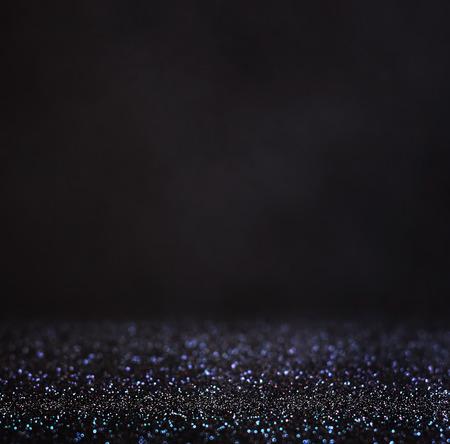 glitter vintage lights background. light silver and black. defocused. photo