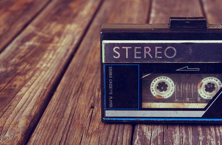 cassette: Old portable cassette player on a wooden background.  Stock Photo