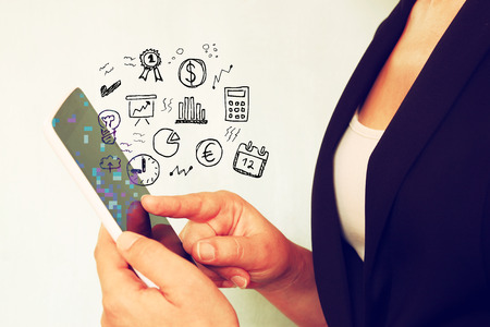 woman tablet: young woman using tablet device and set of business sketches. Stock Photo