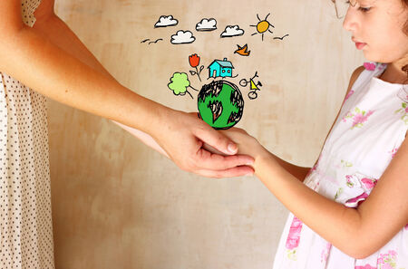 peaceful: photo of mother and child holding hands and showing a better world concept with set infographics . protection and education concept Stock Photo