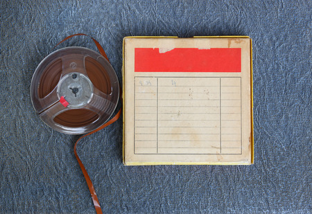 transparence: top view of  old sound recording tape, reel to reel type and box with room for text. filtered image Stock Photo