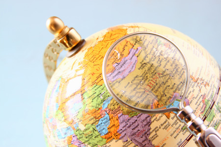 north china: Close up of old vintage globe and magnifying glass. china