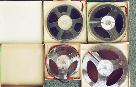 transparence: top view of old sound recording tape, reel to reel type and box.