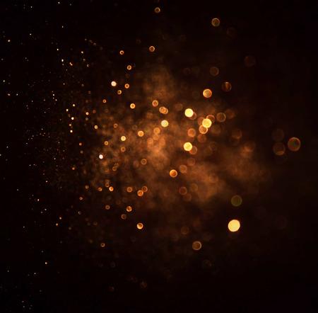 textura oro: brillar las luces de fondo de la vendimia. oro oscuro y negro. desenfocado