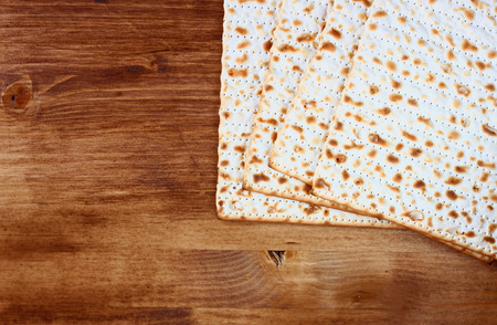 matzos: top view of matzoh (jewish passover bread) over wooden background.
