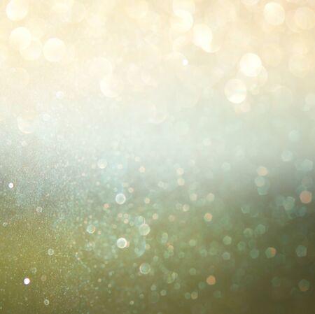 glitter vintage lights background. light gold, green and black. defocused. photo