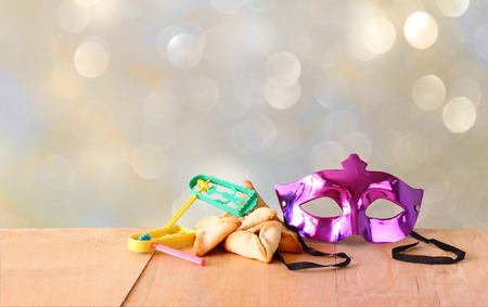 hamantash: Hamantaschen cookies or hamans ears,noisemaker and mask for Purim celebration (jewish holiday) and glitter background