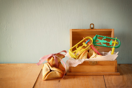 holiday maker: Hamantaschen cookies or hamans ears and mask for Purim celebration (jewish holiday)