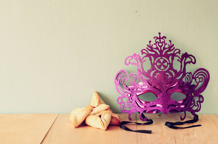 hamantaschen: Hamantaschen cookies or hamans ears and mask for Purim celebration (jewish holiday). retro filtered image Stock Photo