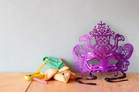 hamantash: Hamantaschen cookies or hamans ears and mask for Purim celebration (jewish holiday)