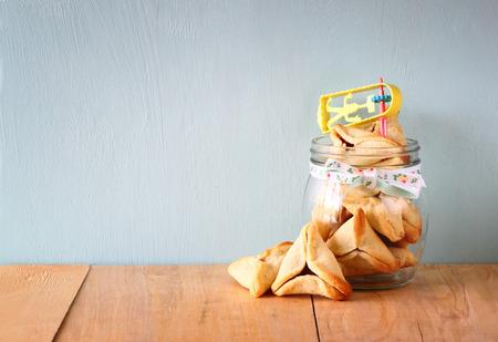 holiday maker: Hamantaschen cookies or hamans ears Purim celebration (jewish holiday).