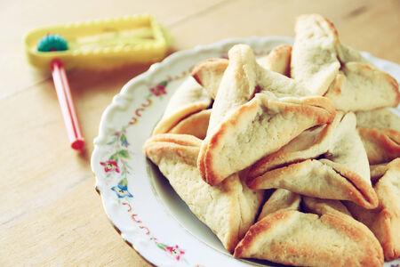 hamantash: Hamantaschen cookies or hamans ears and gragger for Purim celebration (jewish holiday)