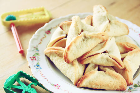 hamantaschen: Hamantaschen cookies or hamans ears and noisemaker for Purim celebration (jewish holiday)