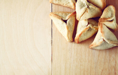 noisemaker: Hamantaschen cookies or hamans ears for Purim celebration (jewish holiday)