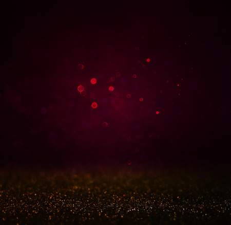 blurred abstract dark red, brown and gold bokeh lights and textures. image is defocused Фото со стока