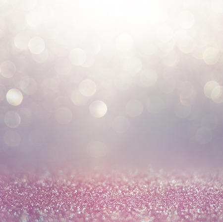 glitter vintage lights background. blue and purple defocused