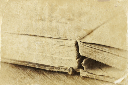 black empowerment: old style photo of book detail with texture and sepia tone