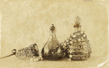 perfume woman: vintage antique perfume bottles, on wooden table. retro filtered image.  Old style photo. Stock Photo