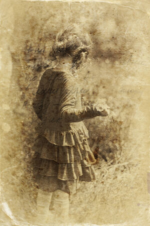 old photograph: cute little girl playing in the garden. filtered image, old style photo Stock Photo