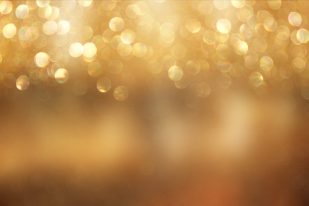 shimmer: abstract background of golden bokeh lights. Stock Photo