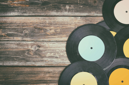 close up image of old records over wooden background , image is retro filtered . Stock Photo