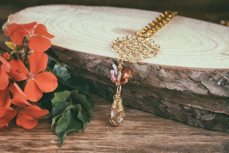 antique background: antique vintage necklace on wooden table. retro filtered image Stock Photo