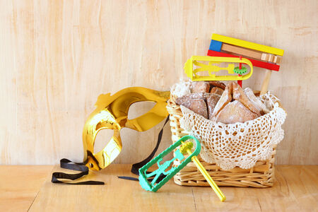 holiday maker: Hamantaschen cookies or hamans ears and noisemaker for Purim celebration (jewish holiday)