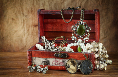 collection: A collection of vintage jewelry in antique wooden jewelry box