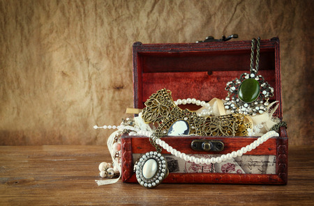 antique jewelry: A collection of vintage jewelry in antique wooden jewelry box