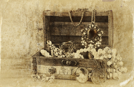antique jewelry: A collection of vintage jewelry in antique wooden jewelry box.  Stock Photo