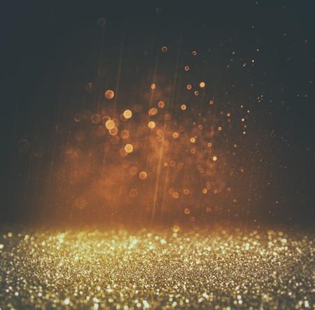 glitter vintage lights background. light gold and black