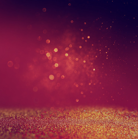 glitter vintage lights background. gold, red and purple. defocused photo