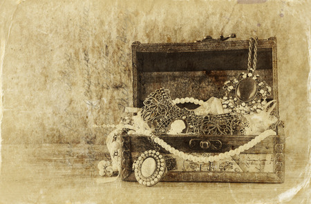 collection: A collection of vintage jewelry in antique wooden jewelry box. retro filtered image. Old style photo.