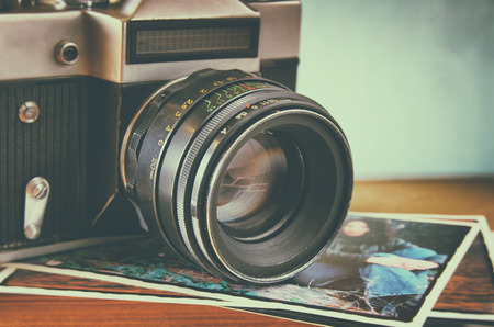 close up photo of old camera lens over wooden table. image is retro filtered. selective focus Stok Fotoğraf