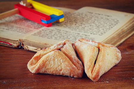 megillah: Hamantaschen cookies or hamans ears Purim celebration (jewish holiday). selective focus Stock Photo