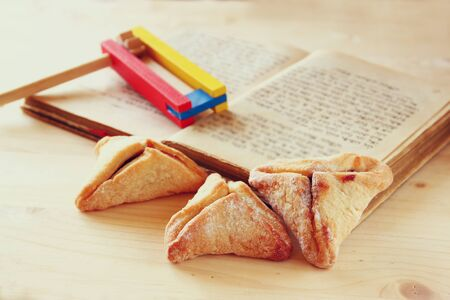 hamantaschen: Hamantaschen cookies or hamans ears Purim celebration (jewish holiday). selective focus Stock Photo