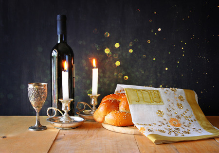 Sabbath image. challah bread and candelas on wooden table