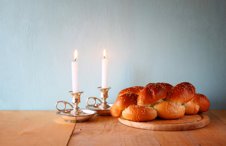 Sabbath image. challah bread and candelas on wooden table photo