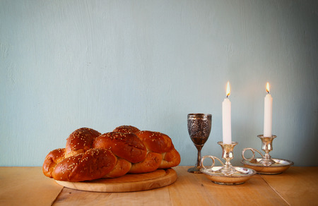 kiddush: Sabbath image. challah bread and candelas on wooden table