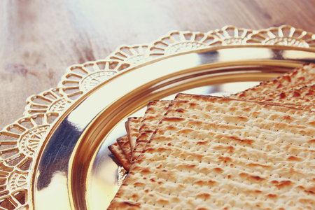 matzos: top view of passover background. egg and matzoh (jewish passover bread) over wooden background.