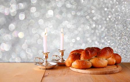 sabbath: Sabbath image. challah bread and candelas on wooden table. glitter overlay