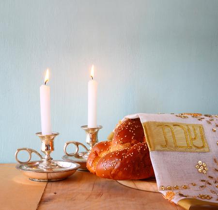 sabbath: Sabbath image. challah bread and candelas on wooden table