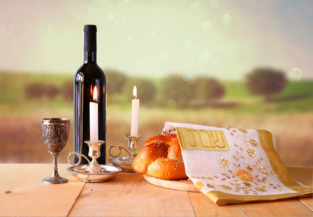 kosher: Sabbath image. challah bread and candelas on wooden table